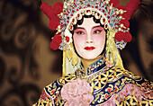 Traditional Peking Opera performer/singer on stage at the Li Yuan Theatre. Pekin, China