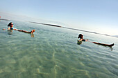 Women floating in the Dead Sea, Ein Bokek, Israel