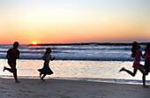 Children in sunset on the Mediterranean, Tel Aviv, Israel