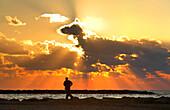 Jogger in sunset, Mediterranean, Tel Aviv, Israel