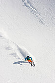 Skier freeriding in Guspis valley, Gemsstock skiing region, Andermatt, Canton Uri, Switzerland