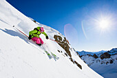 Female skier freeriding, Gemsstock skiing region, Andermatt, Canton Uri, Switzerland