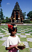 Young lady offering in a bouddhist ritual. Klungkung. Bali. Indonesia