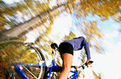 Ability, Activity, Bicycle, Bicycles, Bicyclist, Bicyclists, Bike, Biker, Bikers, Bikes, Biking, Blurred, Color, Colour, Contemporary, Cycle, Cycles, Cycling, Daytime, Exercise, Exterior, Female, Fit, Forest, Forests, Health, Healthy, Horizontal, Human,
