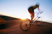ability, activity, adult, bicycle, bicyclist, biker, blurred motion, Color image, contemporary, cycle, cycling, day, energy, exercise, fit, free, freedom, health, healthy, horizon, horizontal, human, leisure, Male, Man, Man only, motion, mountain biking,