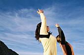 Women practicing yoga in Snow Canyon State Park. Utah, USA