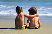 Two young girls together on the beach