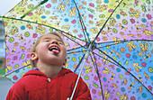 Girl catching raindrops
