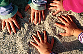Kids hands at the beach