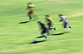 Ability, Action, Activity, Adult, Adults, Blurred, Color, Colour, Competition, Contemporary, Country, Countryside, Daytime, Exterior, Fast, Fitness, Focus, Footbal players, Football player, Footballer, Footballers, Grass, Hobbies, Hobby, Horizontal, Huma