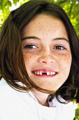 young girl without tooth