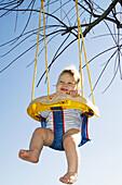 infant on swing