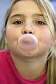 girl blowing gum bubble