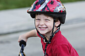 Smiling boy with bike helmet