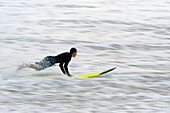 Surfer goint into the water