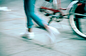 Action, Activity, Adult, Adults, Bicycle, Bicycles, Bike, Bikes, Biking, Blurred, Color, Colour, Contemporary, Cycle, Cycles, Daytime, Detail, Details, Exercise, Exterior, Fit, Fitness, Health, Healthy, Horizontal, Human, Jog, Jogger, Joggers, Jogging, L