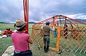 Men assemblying a yurt. Arkhangai. Mongolia