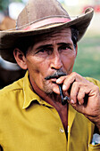 Adult, Adults, Baby boomer, Baby boomers, Caribbean, Color, Colour, Cuba, Daytime, Ethnic, Ethnicity, Exterior, Farmer, Farmers, Greater Antilles, Hat, Hats, Headgear, Human, Latin America, Looking at camera, Male, Man, Mature Adult, Mature Adults, Matur