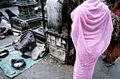 Beggars. Buddhist temple. Asan Tole. Kathmandu. Kathmandu Valley. Nepal