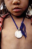 Silver necklace, Tharu girl. Tarai region, Nepal