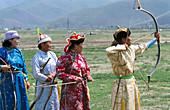 Archery competitors in traditional costume. Naadam Festival. Ulan Bator. Mongolia