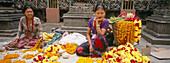 Flower vendors at entrance of temple. Kathmandu, Nepal