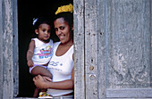 Woman with daugther at her home in Trinidad. Cuba