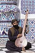 Shah Abdul Latif tomb. Sufi musician. Village of Bhit Shah. Sind Province. Pakistan