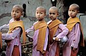 Myanmar (Burma). Mandalay. Buddhist nun procession