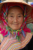 Vietnam. North Vietnam. Bac Ha area. Flower Hmong ethnic group at Can Cau market.