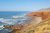 Morocco. Beach and red cliff of Legzira. Around Sidi Ifni. Atlantic coast. 150 km south from Agadir.