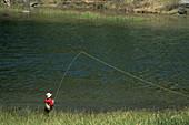 Young male boy fly fishing in alpine Mack Lake, Little Lakes Valley, Rock Creek, Inyo NF, Eastern Sierra, California