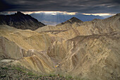 Storm clouds and sun beams over Golden Canyon, Death Valley National Park, California