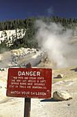 Danger warning sign next to hydrothermal hot spirng at Bumpass Hell, Lassen Volcaninc National Park, California