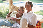 rs, 50-60 years, Adult, Adults, Affection, Bond, Bonding, Bonds, Calm, Calmness, Caucasian, Caucasians, Color, Colour, Contemporary, Couple, Couples, Daytime, Drink, Drinking, Embrace, Embracing, Exte