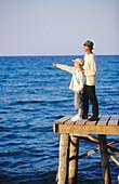 Exterior, Families, Family, Father, Fathers, Full-body, Full-length, Hat, Hats, Headgear, Horizon, Ho