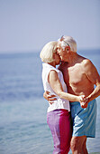 uples, Daytime, Embrace, Embracing, Exterior, Female, Fondness, Gray-haired, Grey-haired, Grin, Grinn