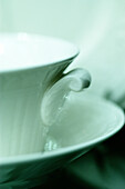 Close up, Close-up, Closeup, Color, Colour, Concept, Concepts, Cup, Cups, Detail, Details, Elegance, Elegant, Handle, Handles, Indoor, Indoors, Inside, Interior, Object, Objects, One, One item, Porcelain, Saucer, Saucers, Still life, Thing, Things, Verti