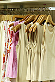 Clothing store, Color, Colour, Concept, Concepts, Detail, Details, Fashion, Feminine, Garment, Hang, Hanger, Hangers, Hanging, Indoor, Indoors, Inside, Interior, Shopping, Still life, Style, T shirt, T-shirt, Tee shirt, Tee shirts, Vertical, F58-276847,