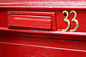Arrangement, Close up, Close-up, Closeup, Color, Colour, Concept, Concepts, Daytime, Door, Doors, Exterior, Horizontal, Mailbox, Mailboxes, Number, Number 33, Number thirty-three, Numbers, Order, Outdoor, Outdoors, Outside, Slot, Slots, Urban, Wood, Wood