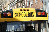 America, Bus, Buses, Busses, Cities, City, Coach, Coaches, Color, Colour, Concept, Concepts, Daytime, Detail, Details, Exterior, Horizontal, North America, Outdoor, Outdoors, Outside, Public transport, Public transportation, School bus, Sign, Signs, Stre