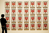 Visitor looking at Campbell s Soup cans by Andy Warhol, Museum of Modern Art. New York City. USA