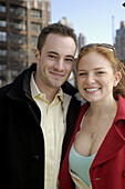 Adult, Adults, Caucasian, Caucasians, Close up, Close-up, Closeup, Color, Colour, Contemporary, Couple, Couples, Daytime, Exterior, Eyeglasses, Face, Faces, Facial expression, Facial expressions, Facing camera, Female, Glasses, Grin, Grinning, Happiness,
