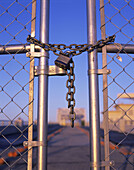 Padlocked security gate.