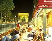 Street scene, Cafe, Champs elysees & Arch de triomphe, Paris, France.