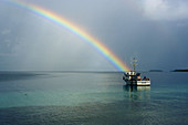Rainbow and ship, Namu atoll, Marshall Islands (North Pacific)