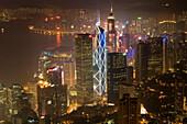Hong Kong s modern skyline overlooking Victoria harbour and Kowloon peninsula at night, Hong Kong, China