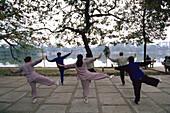 People exercising by Lake Hoan Kiem. Hanoi. Vietnam