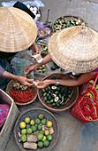 Women trading at market. Vietnam