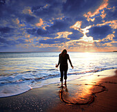 Beach, Beaches, Color, Colour, Concept, Concepts, Contemporary, Emotion, Emotions, Evening, Exterior, Full-body, Full-length, Heart, Hearts, Human, Love, Mood, One, One person, Outdoor, Outdoors, Outside, People, Person, Persons, Romance, Sea, Shore, Sho